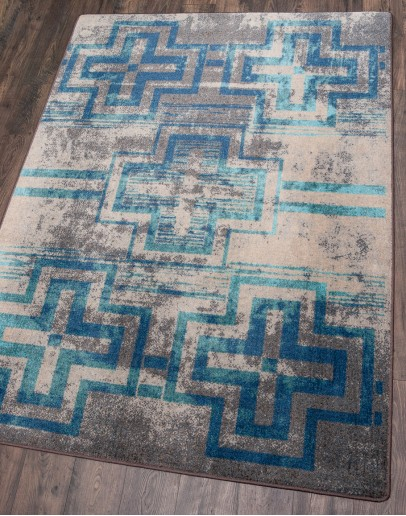 southwestern style rug with light blues and greys