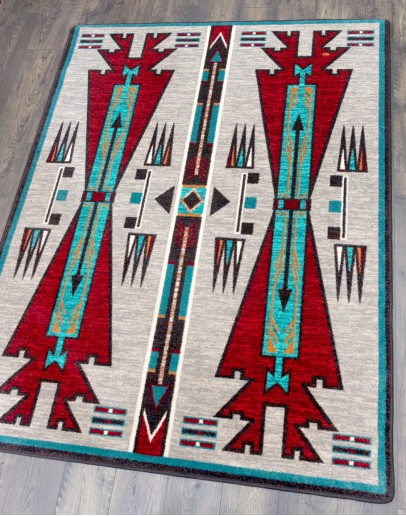 rug with turquoise and rust colors