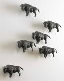 small metal buffalo sculpture
