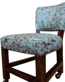 game chair with light blue leather and twisted fringe