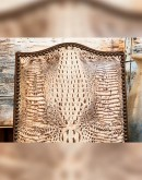 fine dining chair with a white embossed croc pattern leather