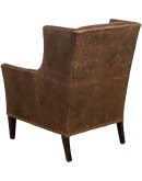 distressed brown leather chair with boot stitch emblem on seat back