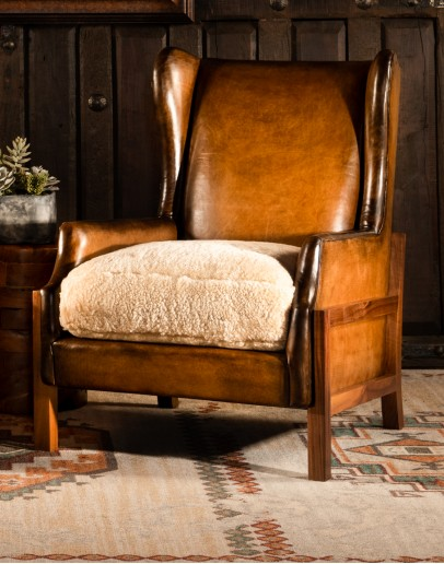 modern rustic leather chair with exposed wood arms