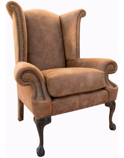large distressed tan leather wingback chair