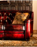 red leather sofa with tufted seat back