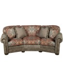 curved sofa with fabric and leather accents
