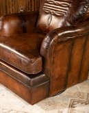 leather chair with a boot stitch design on seat back
