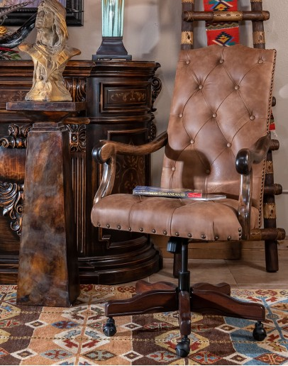 desk chair with distressed tan tufted leather
